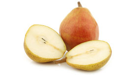 Fresh doyenné de comice pear and a cut one Stock Image
