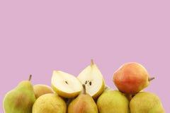 Fresh doyenne de comice pear and a cut one Stock Photos