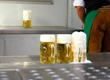 Fresh draft three liters beer at Oktoberfest. Close up Stock Photography