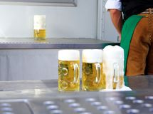 Fresh draft three liters beer at Oktoberfest. Close up Royalty Free Stock Photo