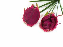 Fresh dragon fruit cut in half. And leaves behind a decoration o Stock Photography
