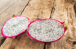 Fresh dragon fruit on wooden background. Fresh dragon fruit on wooden table background Royalty Free Stock Photography