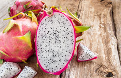 Fresh dragon fruit on wooden background Stock Images