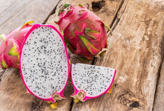 Fresh dragon fruit on wooden background Royalty Free Stock Images