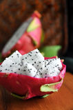 Fresh dragon fruit on wooden board Stock Photo