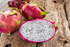Fresh dragon fruit on wooden table Stock Images