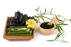 Fresh and dried bamboo and Bamboo charcoal powder. Fresh and dried bamboo and Bamboo charcoal powder, using a combination of personal care products such as soap Stock Image