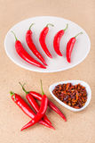 Fresh and dried chili peppers Stock Image