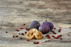 Fresh and dried figs with berries Royalty Free Stock Photos