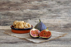Fresh and dried figs on wood Stock Image