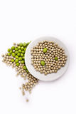 Fresh and dried green peas on plate Stock Photography