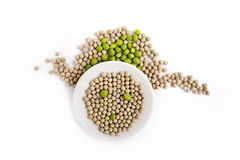 Fresh and dried green peas on plate Royalty Free Stock Photos