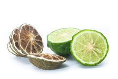 Fresh and Dried Kaffir Lime,  on white, food ingredient Royalty Free Stock Photos