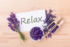 Card with text: Relax. Fresh and dried lavender and card with text: Relax on a wooden background Royalty Free Stock Photo