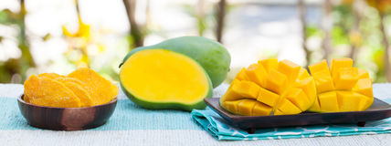 Fresh and dried mango fruit with smoothie juice. On a outdoor tropical background Copy space Stock Photos