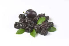 Fresh and dried plums Royalty Free Stock Images