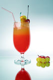 Fresh drink. Decorated fruits with the straw Royalty Free Stock Images