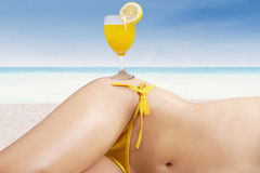 Fresh drink on the beautiful body Stock Image