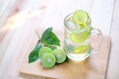 Fresh drink lime juice on wooden background. royalty free stock photography