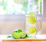 Fresh drink lime juice on wooden background. royalty free stock photos