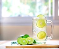 Fresh drink lime juice on wooden background. royalty free stock images