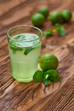Fresh drink photo of home made lemonade on wooden background Stock Photo