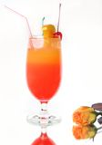 Fresh drink and rose. Fresh drink decorated fruits with a rose Stock Image