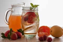 Fresh drink with strawberries, lemon and mint. stock photo