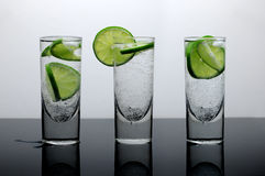 Fresh drink - water with lime and ice Royalty Free Stock Images