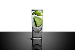 Fresh drink - water with lime and ice Stock Photo