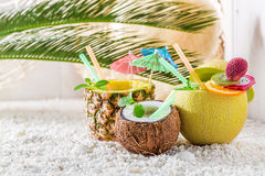 Fresh drinks in fresh fruits with cocktail umbrellas Stock Image