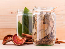 Fresh and dry bay leaves in bowl Stock Images