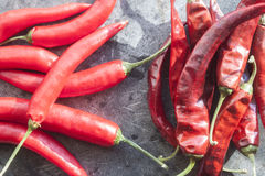 Fresh and dry chili. On a stone plate Royalty Free Stock Image