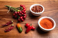 Fresh and dry hot peppers royalty free stock photos