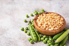 Fresh and dry peas on light background. Selective focus Royalty Free Stock Photography