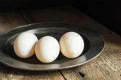 Fresh duck eggs in moody vintage retro style natural lighting se Stock Photo