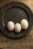 Fresh duck eggs in moody vintage retro style natural lighting se. Fresh duck eggs in moody vintage style natural lighting set up Stock Photo