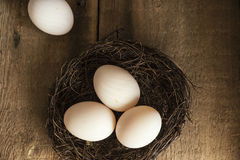 Fresh duck eggs in moody vintage retro style natural lighting se. Fresh duck eggs in moody vintage style natural lighting set up Royalty Free Stock Images
