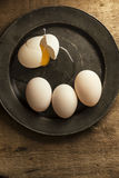 Fresh duck eggs in moody vintage retro style natural lighting se Stock Image