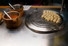 Fresh dumplings on a stove of a stall at a typical night market in Taipei royalty free stock photos