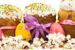 Fresh easter cakes with colorful decorative eggs and spring flow Stock Image