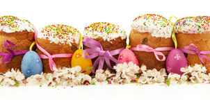 Fresh easter cakes with colorful decorative eggs and spring flow Stock Photos