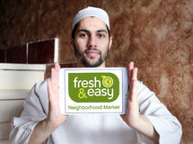 Fresh and easy grocery stores logo. Logo of the international chain of grocery stores fresh and easy on samsung tablet holded by arab muslim man Royalty Free Stock Photography