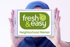 Fresh and easy grocery stores logo. Logo of the international chain of grocery stores fresh and easy on samsung tablet holded by arab muslim woman Royalty Free Stock Photography