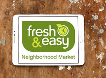 Fresh and easy grocery stores logo. Logo of the international chain of grocery stores fresh and easy on samsung tablet on wooden background Royalty Free Stock Image