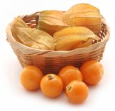 Fresh edible physalis. In a basket over white background Stock Photo