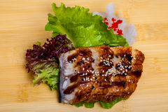 Fresh eel sashimi on a wooden textured desk Stock Images
