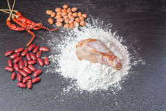Fresh egg in flour , Peanuts with red lentils Chicken and wooden rolling on black chalkboard. Royalty Free Stock Photography