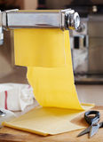 Fresh egg pasta rolled in pasta machine Royalty Free Stock Photography