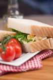 Fresh egg and rocket on white sandwich in rustic kitchen setting Royalty Free Stock Photos